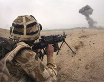 A British commando engages Taliban positions