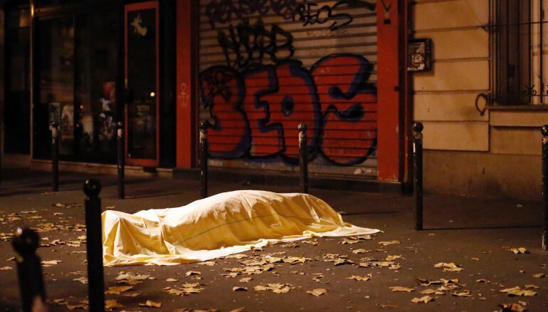 A body, covered by a sheet, outside the Bataclan theater