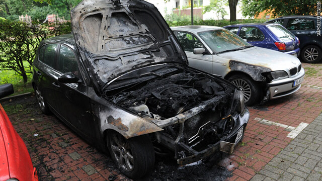 A burned-out BMW can be seen at a car park in Berlin