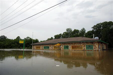 A business being submerged as floodwaters rise in Memphis