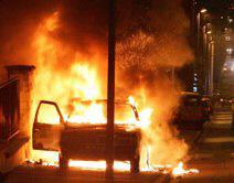 A car burns early Saturday in a street in Pierrefitte, north of Paris
