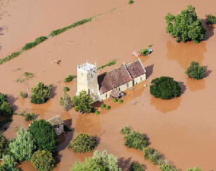 urrounded by a sea of floodwater, a church in Tirley, Gloucestershire.
