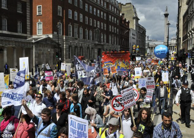 A crowd of protesters snakes through London as marches take place across the country, sparked by a proposed increase in the retirement age for public sector workers and having to pay more into their pensions