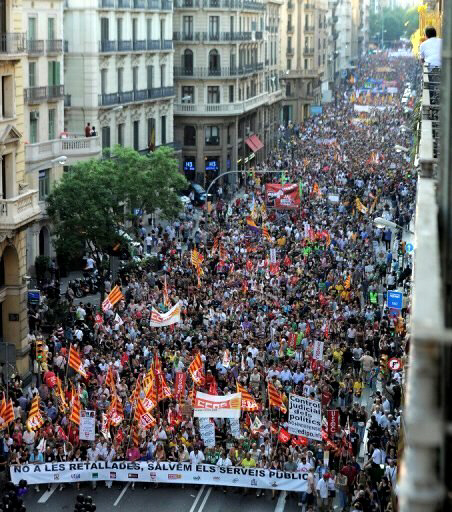 A demonstration organized by unions takes place in Barcelona. Spanish police fired rubber bullets and charged protestors in central Madrid early Friday at the end of a huge demonstration against economic crisis measures. (AFP Photo/Lluis Gene)
