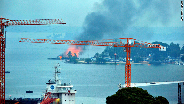 A fire is seen at a naval base controlled by forces loyal to strongman Laurent Gbagbo in Abidjan, Ivory Coast, on Sunday