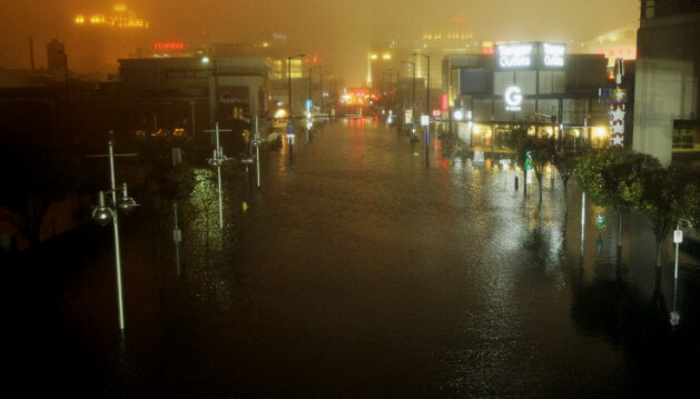 A flooded street at nightfall during storm in Atlantic City, NJ