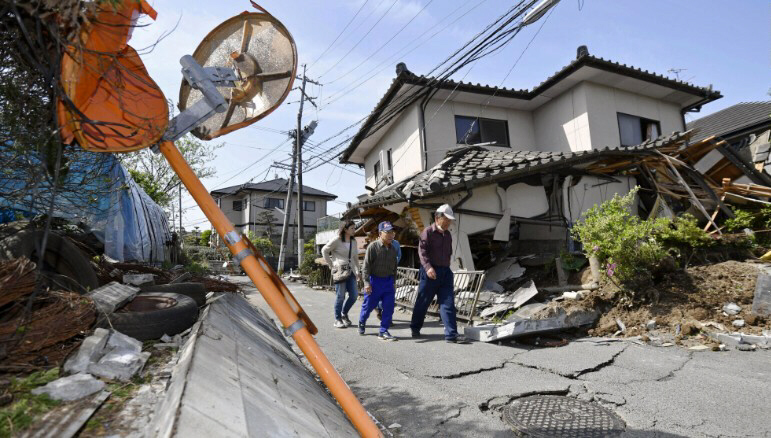 A house in Mashiki teeters after the 6.2 quake