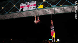 A man and woman hang from pedestrian bridge in Nuevo Laredo, Mexico