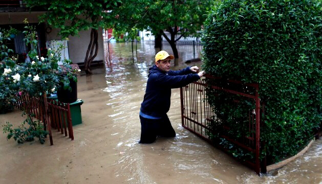 A man walks outside his home after severe floods in Obrenovac, Serbia