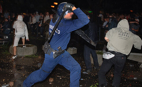 A police officer beats those participating in the demonstration