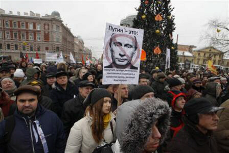 A protestor holds a placard during a demonstration against Putin