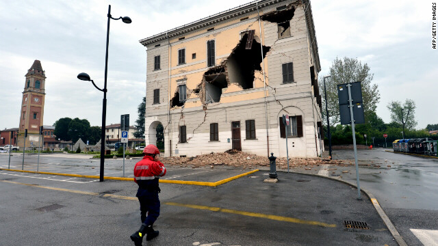 A rescuer walks near the town hall in Sant'Agostino village