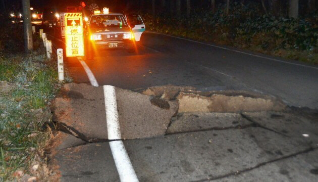 A road buckled after a strong earthquake hit central Japan