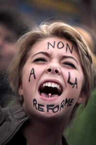 A student shouts slogans as she demonstrates in Paris.