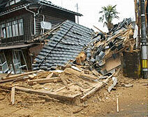 A warehouse lies destroyed by the earthquake in Ishikawa prefecture