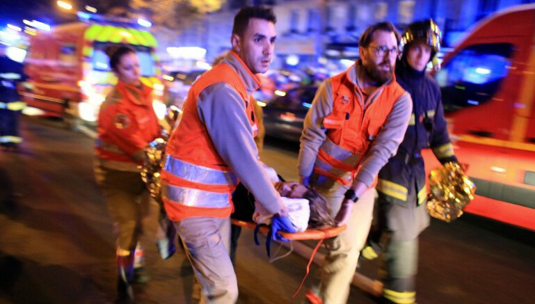 A woman is evacuated from the Bataclan theater