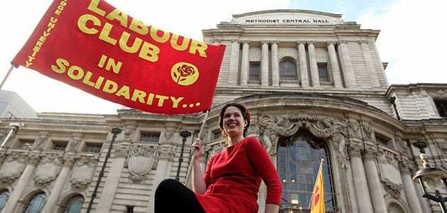 A woman joins protest of unions near Parliament in London