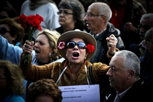 A woman protests during a demonstration in downtown Lisbon