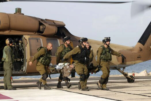 A wounded Israeli soldier is brought to a hospital in Haifa