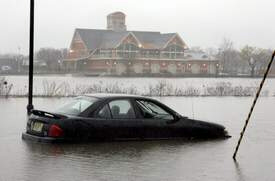 Abandoned car sits in water that overflowed banks of Cooper River