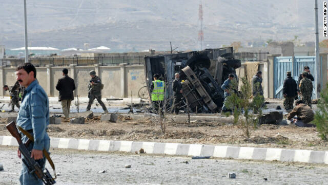 Afghanistan's security forces inspect the site of a suicide attack in Kabul