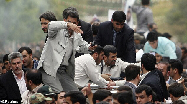 Ahmadinejad and bodyguards react after hearing explosion