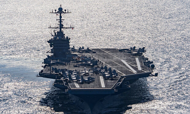 Aircraft carrier USS Harry S. Truman navigates the Gulf of Oman