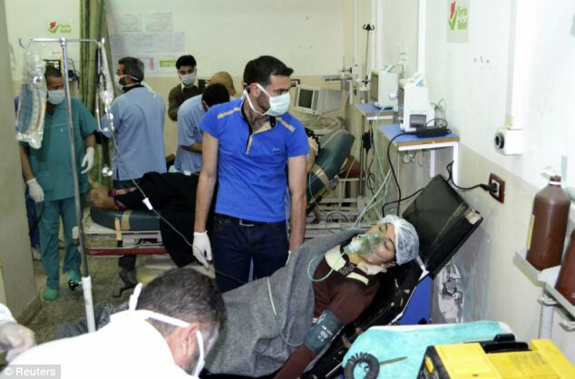 Another female victim is pictured at Bab al-Hawa hospital