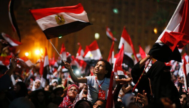 Anti-Morsy protesters wave flags