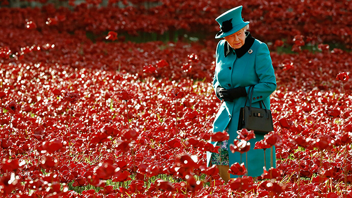 Britain's Queen Elizabeth walks through a field of ceramic poppies
