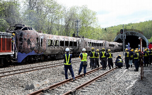 Burned wreckage of derailed Japanese express train