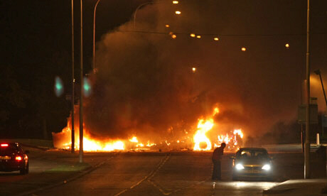 Burning bus blocks road in Newtownabbey, Northern Ireland