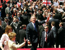 Bush waves to people in the crowd after speaking in Freedom Square in Tbilisi