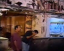 Bystanders examine damage to shops Monday after a bomb detonated nearby in Dahab, Egypt