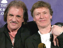 Capaldi, left, and Winwood are inducted into Rock and Roll Hall of Fame in 2004