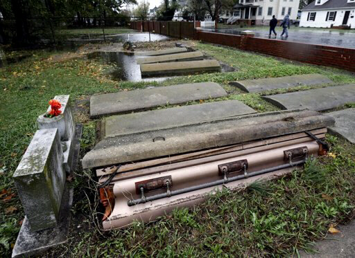 Caskets floated out of graves in a cemetery in Crisfield, Md