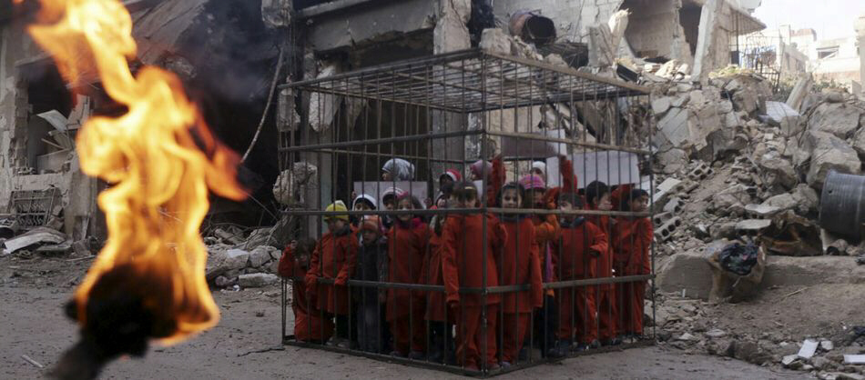 Children, most likely captive prisoners, held in a cage