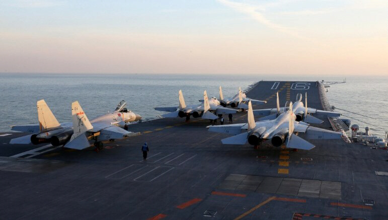 Chinese J-15 fighter jets wait on the deck of the Liaoning aircraft carrier
