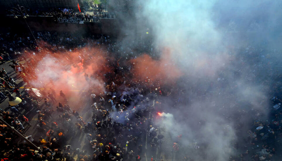Colorful smoke flares ignite in downtown Rome as demonstrators march on Saturday, October 15, and the Occupy Wall Street movement goes global. What started as a peaceful protest turned violent, resulting in injuries to at least 70 people.