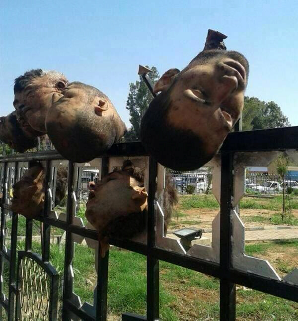 Decapitated heads on city fence