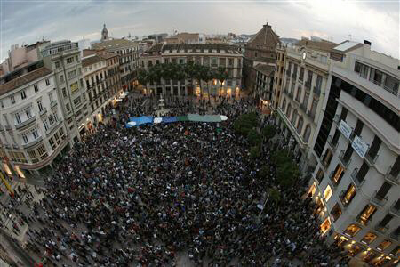 Demonstrators fill up La Constitucion square during a demonstration in Malaga, southern Spain May 20, 2011. REUTERS/Jon Nazca
