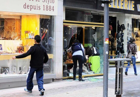 Demonstrators smash shop windows during riots in downtown Lyon, France, 19 October 2010, during a High School students demonstration. EPA/OLIVIER CHASSIGNOLE