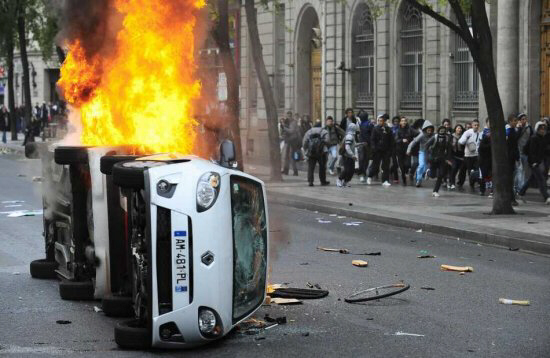 Demonstrators vandalize cars in downtown Lyon, France, 19 October 2010, during a High School students demonstration. EPA/OLIVIER CHASSIGNOLE.