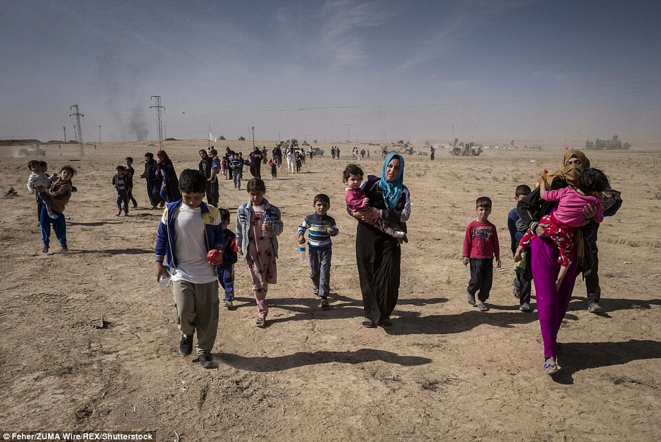 Desperate families escaping from ISIS-controlled Khorsabad