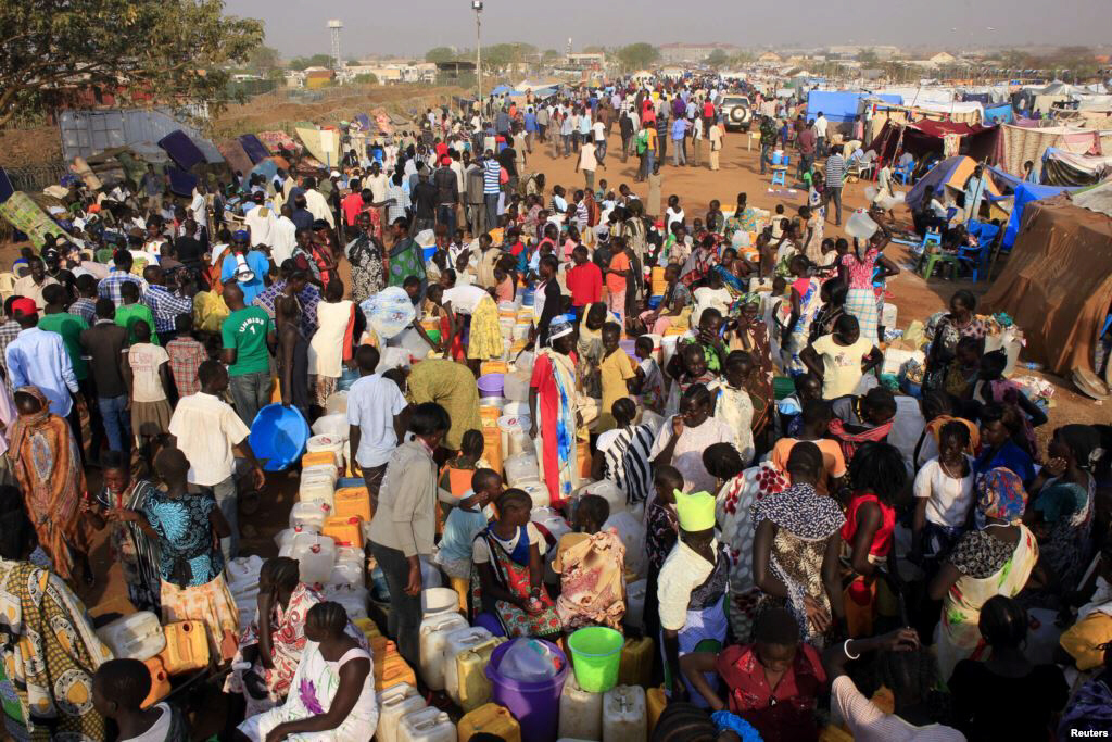 Displaced people walk around Tomping camp in Juba, where some 15,000 people who fled their homes are sheltered by the United Nations.