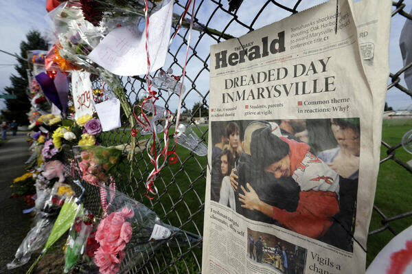 'Dreaded Day in Marysville' headline shown as part of growing memorial