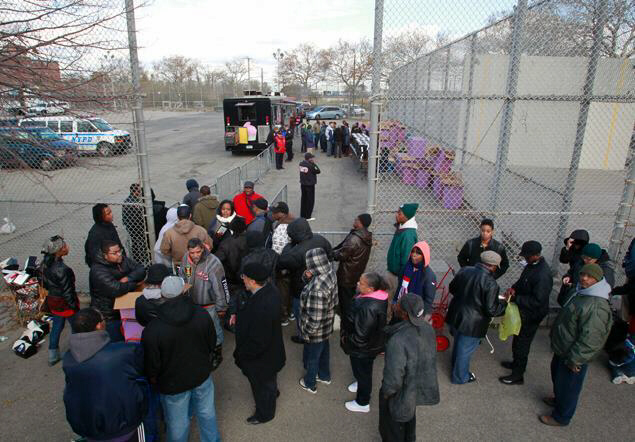 Far Rockaway residents fall in line as FEMA gives out food and water