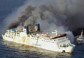 Thick smoke pours out of sinking Superferry