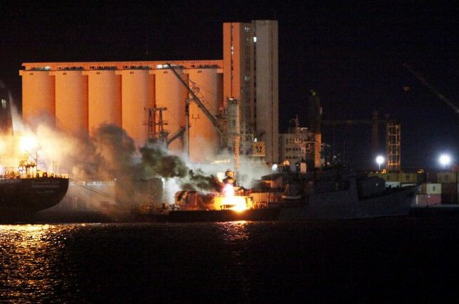 Fire aboard ship in port hit by North Korean airstrike
