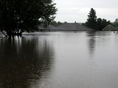 Flooding from Souris approaches roofs of two homes in Burlington
